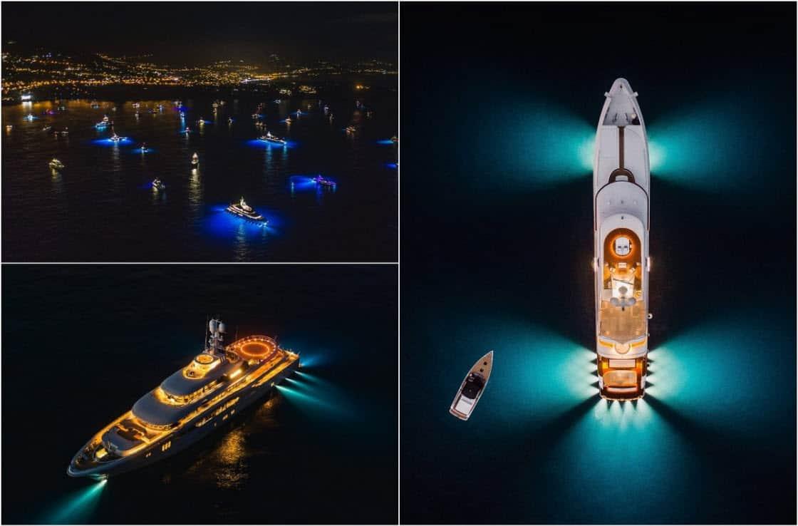 Десятки суперяхт светятся ночью яркими огнями, стоя на якоре у побережья Монако (13 фото)